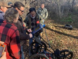 UMaine at Presque Isle Professor Chunzeng Wang discusses mapping tools with students and community volunteers