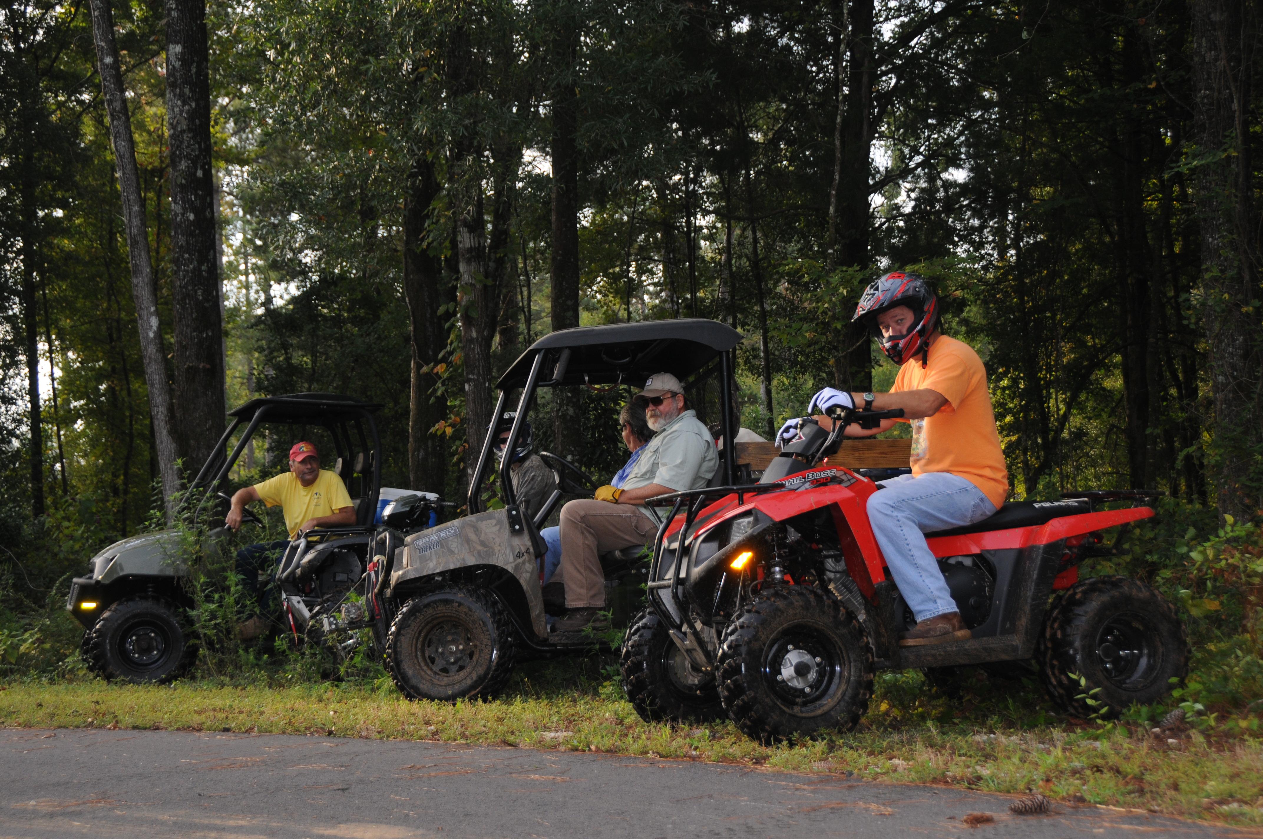 Recreational riders on all-terrain vehicles
